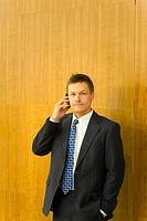 Businessman posing while talking on the mobile phone
