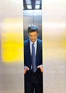 Businessman opening the elevator doors (thumbnail)