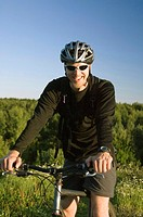 Man smiling while riding on bicycle