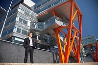 Businessman posing outdoors in front of a building (thumbnail)