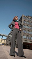 Businesswoman standing with arms akimbo