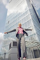 Businesswoman balancing herself while walking in a straight line (thumbnail)