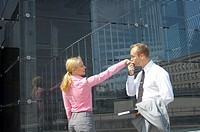 Businessman kissing businesswoman's hand (thumbnail)