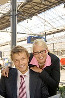 Businessman and businesswoman smiling at the camera
