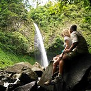 Couple Admiring a Waterfall