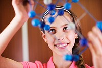 Girl Holding Model of Molecule