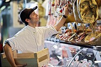 Man Selecting Dry Meats