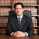 Mixed Race male lawyer at desk