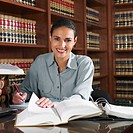 Hispanic female lawyer working in office (thumbnail)