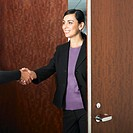 Hispanic businesswoman shaking hands