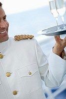 Waiter Carrying Champagne on a Cruise Ship