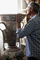 Man Looking Inside Big Vase