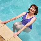 Senior Hispanic woman in swimming pool (thumbnail)