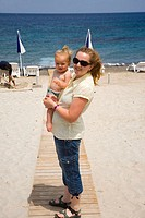 Mother and Daughter enjoying the resort beach in Kos Island. Greece.