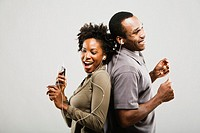 African American couple listening to same mp3 player