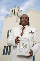 Senior African American man in front of church
