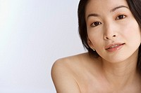Asian woman with bare shoulders