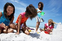 Four Girls Playing in Sand