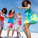 Girls Making Music and Dancing on Beach