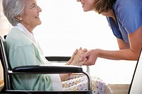 Senior Woman Holding Hands of Nurse