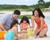 Hispanic family playing at beach