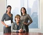 Hispanic businesswomen in conference room (thumbnail)