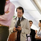 Businessman Text Messaging While Waiting in Line