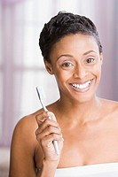 African American woman holding toothbrush