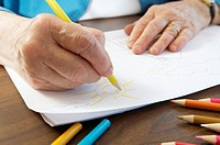 Senior woman drawing cheerful picture