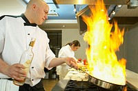 Chef making a flambe