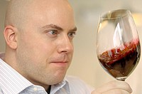 Wine taster with glass of red wine