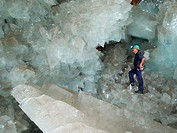 Cave of Crystals  Geologist in the Cave of Crystals Cueva de los Cristales in Naica Mine, Chihuahua, Mexico  The crystals are the largest known in the...