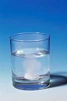 Indigestion tablet dissolving in water  This is an Alka-Seltzer tablet  It is a combination of aspirin, sodium bicarbonate and citric acid  It is desi...