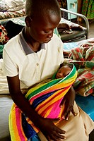 Child and newborn baby in a hospital maternity ward  Photographed in a rural area of the Gulu region of Uganda