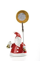 Santa Claus Figurine holding Euro coin