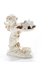 Angel figurine with Star-shaped cinnamon biscuits