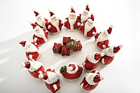 Santa Claus figurines standing in circle