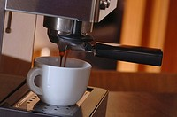 Espresso machine with mug, close-up