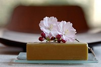 Cherry blossom and a bar of soap, close-up