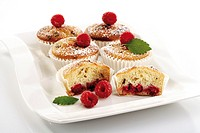 Raspberry muffins on plate, close-up