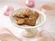 Heart-shaped cookies on white cake stand