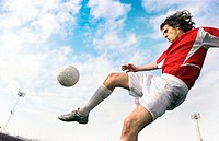 Footballer kicking a ball