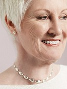 Middle_aged woman looking to side and smiling close_up cropped