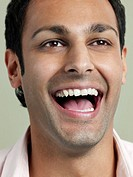 Mid adult man laughing close_up