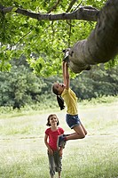 Girl watching friend 7_9 hanging from tree
