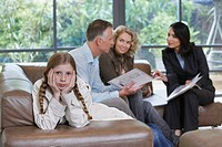 Parents with bored daughter 7_9 and estate agent discussing new property