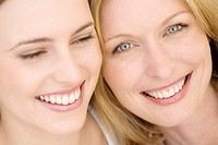 Portrait of two smiling women, indoors