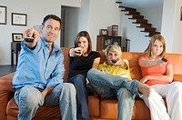 Family watching television, indoors (thumbnail)