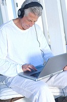 Man with headphones using laptop