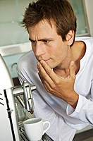 Young man in front of espresso maker (thumbnail)
